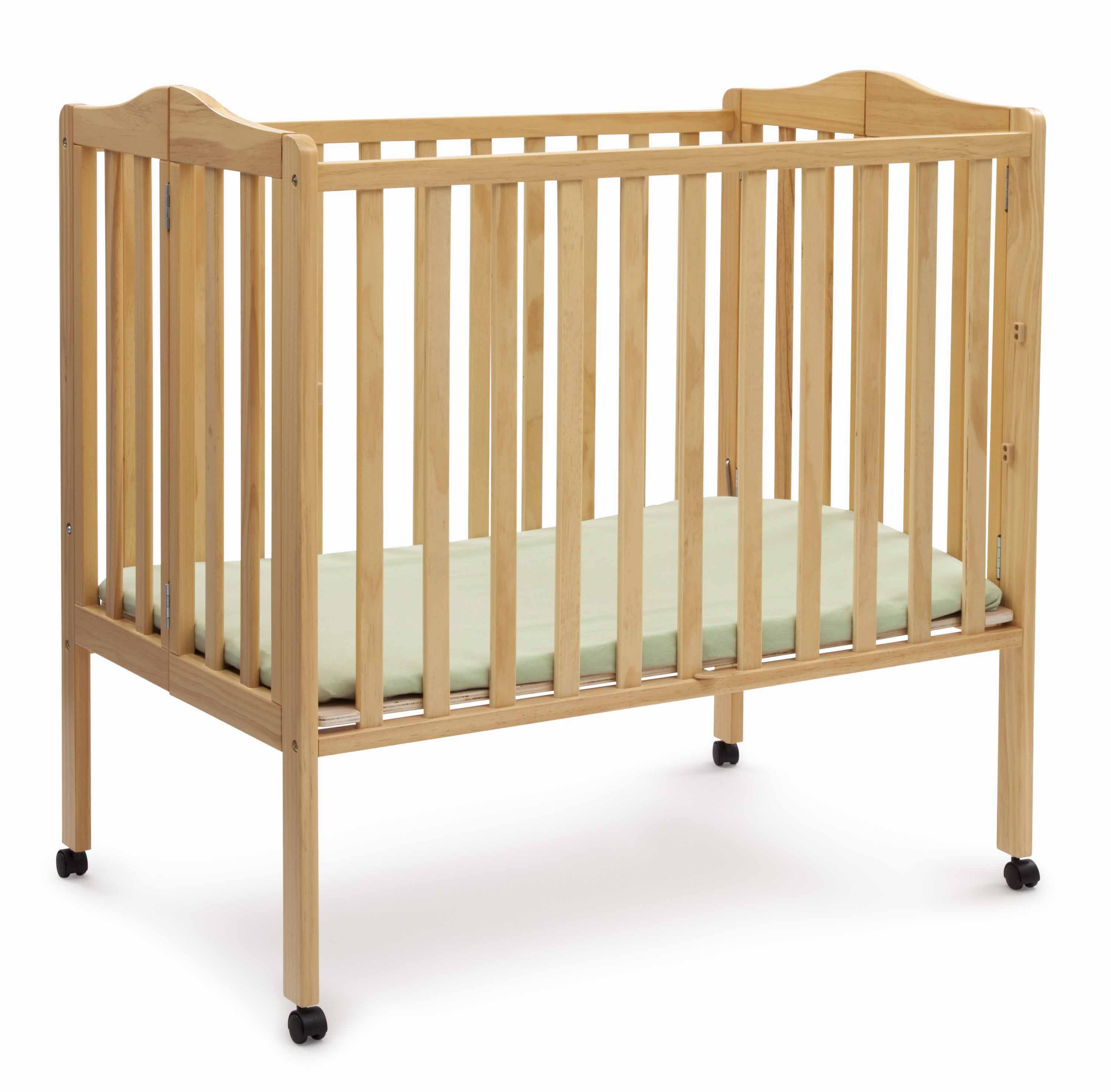 Compact Size Folding Crib With Mattress and Sheets